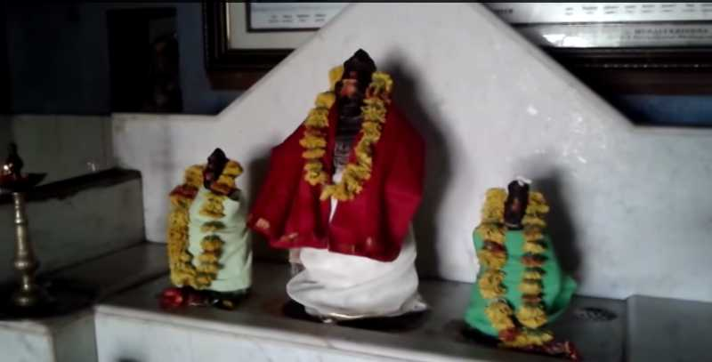 Chitragupta Swamy with his two consorts in the temple
