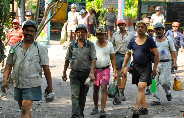 Singareni Collieries Coal Mine Employees leaving mine in response to Sakula Janula Samme